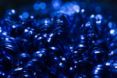 Christmas background with blue tinsel and boker. Holiday design Royalty Free Stock Photography