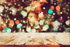 Christmas background and blurred light bokeh with empty wooden deck table. For product montage. Rustic vintage Xmas background stock image