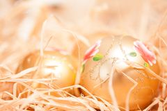 Christmas background with boll and strow in gold royalty free stock photo