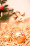 Christmas  background with boll and strow in gold Stock Image