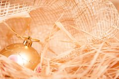 Christmas background with boll and strow in gold stock images