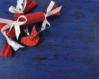 Christmas background with bon bons on dark blue vintage wood. Royalty Free Stock Photography