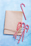 Christmas background. Book for recipe and candycanes Stock Image