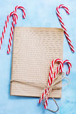 Christmas background. Book for recipe and candycanes Stock Photography