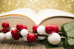 Christmas background with book. Red and white christmas decorations with open book and glittering background Stock Photography