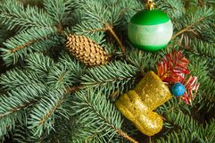 Christmas background, boots with gifts, Christmas balls on fir branches Royalty Free Stock Photos