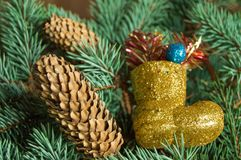 Christmas background, boots, gifts, cones on the Christmas tree branches Royalty Free Stock Photos