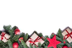 Christmas background border at the bottom with fir branches and. Other decorations like presents red stars and bulbs with copy space isolated on white stock photo