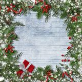 Christmas background with border of candy cane, firtree, holly. Christmas decoration with candy cane, firtree, holly on a holiday background. Greeting Card Stock Images