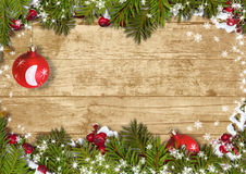 Christmas background with a border of fir branches, ball&holly Stock Photos