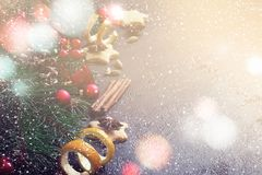 Christmas background border of fir branches and Christmas toys a. Christmas background border of fir branches and Christmas toys, spices, and bokeh lights Royalty Free Stock Photography