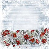 Christmas background with a border fir branches,  red berries and balls on wooden boards. Greeting card Stock Photo