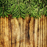Christmas Background Border. Green Xmas Fir Branch on Wooden Stock Photography