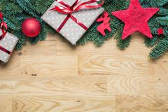 Christmas background border at the top with fir branches and other decorations presents red stars and bulbs with copy space on stock image