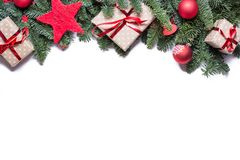 Christmas background border at the top with fir branches and other decorations presents red stars and bulbs with copy space on. Christmas background border at royalty free stock photography