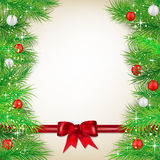 Christmas background with bow, balls and spruce twigs Stock Photo