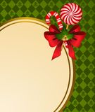 Christmas background with bow and candy. Stock Images