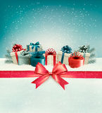 Christmas background with a bow and presents. Royalty Free Stock Photography