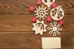 Christmas background with a box, red stars and wooden toys royalty free stock photography