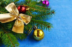 Christmas background. Branch spruce decorated with colorful decorations Stock Photos