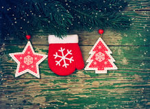 Christmas background with branch spruce, mittens, star and fir Royalty Free Stock Images