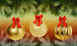 Christmas background with branches Christmas tree and golden baubles Stock Images