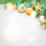 Christmas background with branches and golden ornaments Stock Images