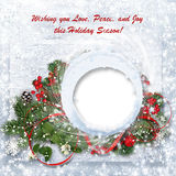 Christmas background with branches, holly and wishes. Christmas tenderness background with snowy branches and Christmas decorations with space for greetings and Stock Photo