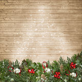 Christmas background with branches, mistletoe and holly on wood Royalty Free Stock Images