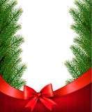 Christmas background with  branches of tree and bow with ribbons Stock Photo
