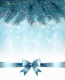 Christmas background with  branches of tree and bow with ribbons Stock Photography