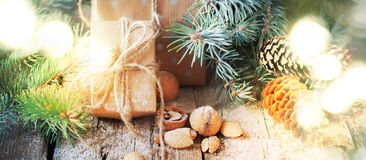 Christmas Background with Bright Light and Festive Natural Presents. Vintage Style. Christmas Background with Bright Light and Festive Natural Presents. Boxes Stock Photography