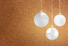 Christmas background with brown bokeh lights and christmas balls Stock Photos
