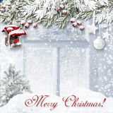 Christmas background with bullfinch on the window and the snow a. Christmas  winter background  with  bullfinch and beautiful  Christmas decorations Stock Photo