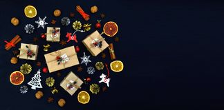 Season of greetings. Celebratory background with gifts, spices a stock image