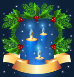 Christmas background with burning candle Stock Images