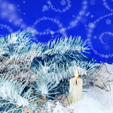 Christmas Background with Burning Candle Stock Image