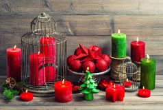 Christmas background burning candles baubles decoration vintage. Christmas background with birdcage, burning candles and baubles decoration. Vintage toned stock photo