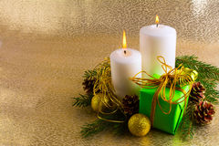 Christmas background with burning candles and gift box Stock Image