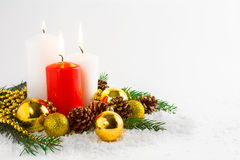 Christmas background with burning candles and golden ornaments Royalty Free Stock Photo