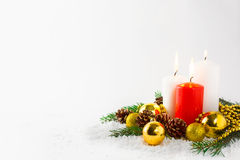 Christmas background with burning candles in snow Royalty Free Stock Photos