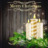 Christmas background. With burning candles and Christmas tree on grey wood Stock Images