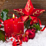 Christmas background with candle and decoration Stock Photos