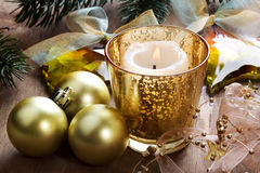 Christmas background with candle and decorations. Christmas background with candle, baubles and pine branches Stock Photo