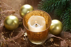 Christmas background with candle and decorations. Christmas background with candle and pine branches on wooden table Royalty Free Stock Image