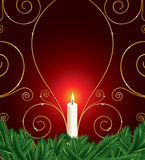 Christmas background with candle and pine leaves Royalty Free Stock Image