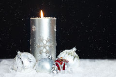 Christmas background with candle and snow falling Stock Photo