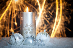 Christmas background with candle and sparklers Royalty Free Stock Photos