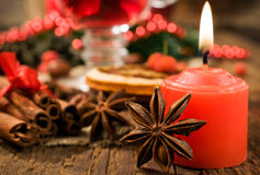 Christmas background : candle and spices Stock Image