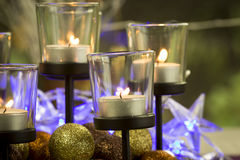 Christmas background with candles and baubles Stock Photo